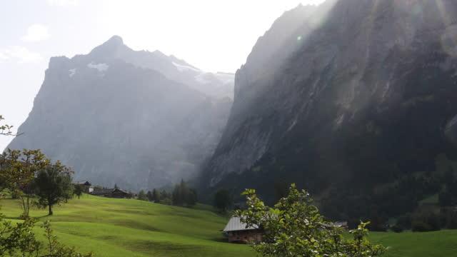 berg och gröna ängen vid soluppgången - grindelwald bildbanksvideor och videomaterial från bakom kulisserna
