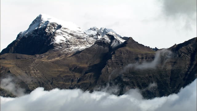 mountains and low clouds  - aerial view - provence-alpes-côte d'azur, hautes-alpes, arrondissement de gap, france - hautes alpes stock videos & royalty-free footage