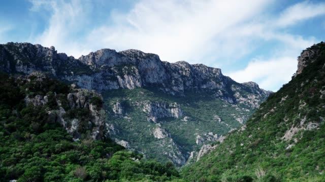 mountains landscape sky with clouds, timelapse - пелопоннес стоковые видео и кадры b-roll
