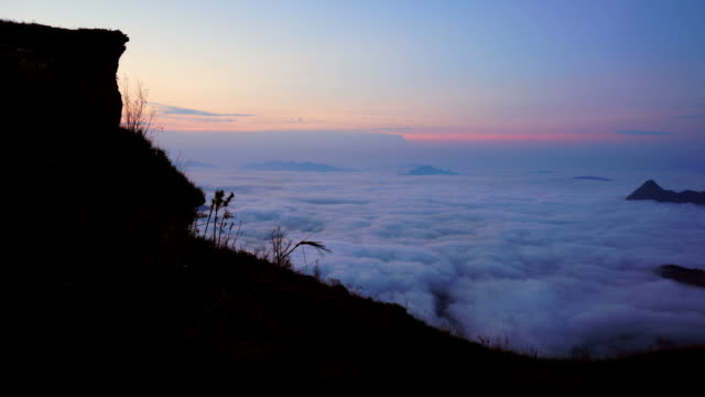 (Time Laspe) mountains landscape with Moving Mist over forest on the sunrise . video