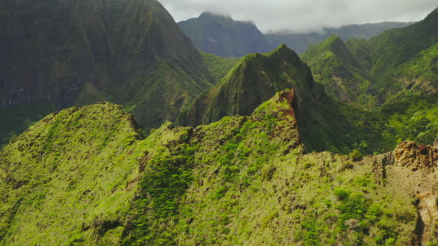 Mountains of Hawaii Cinematic aerial view flying over lush green mountain peaks in Hawaii hawaii islands stock videos & royalty-free footage