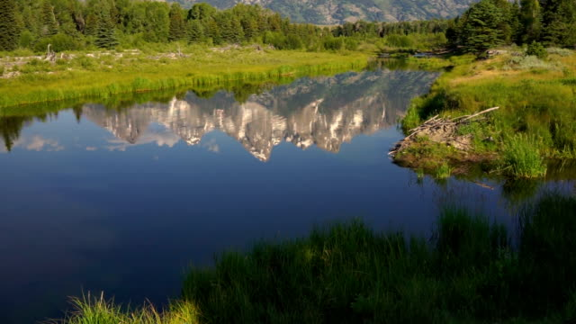 Mountains Reflected Smooth Water Grand Teton National Park video