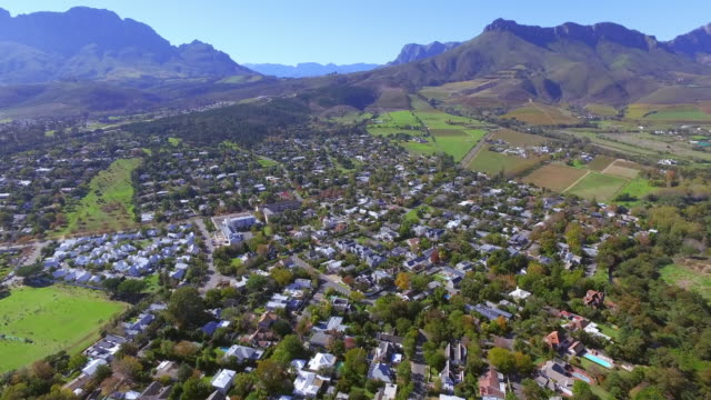 Mountainside community 4k aerial drone footage of a bustling suburban area western cape province stock videos & royalty-free footage