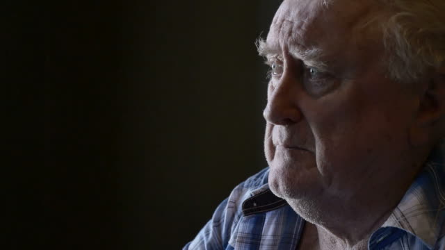 Mournful and alone elderly old man looking glum and grief-stricken video