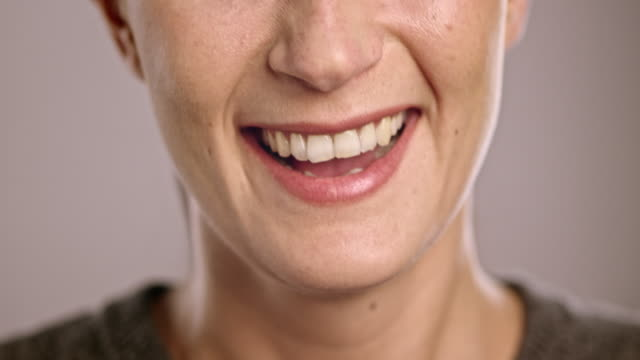 Mouth of a laughing young Caucasian woman video