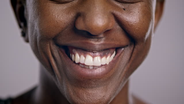 Mouth of a smiling African-American woman video