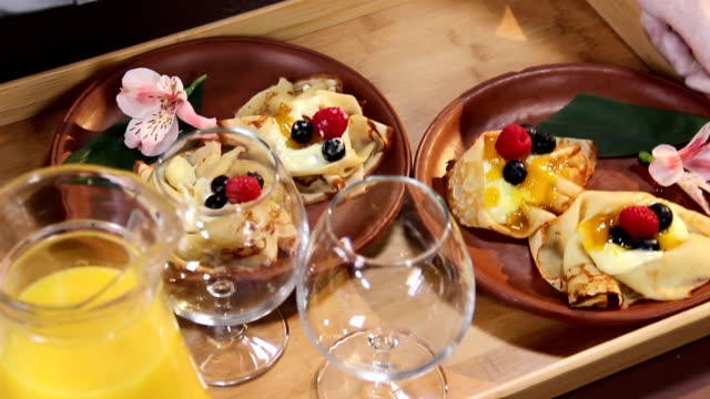 Mouth-watering dessert pancakes served for two persons on a tray video