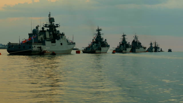 movement along warships in the bay at sunset video