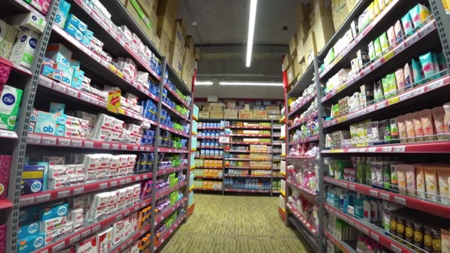 Movement in the store among the shelves.