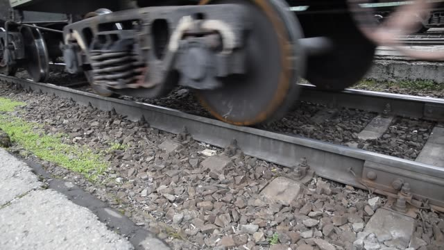 Movement of a freight train. Tanks on rails. Wheels of the train video