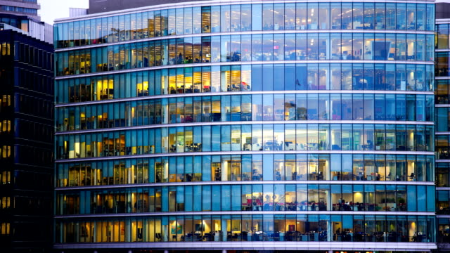 Movement of businessman meeting, Office business building in London, England - timelapse