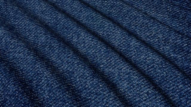 movement of denim material folds. - dżinsy filmów i materiałów b-roll