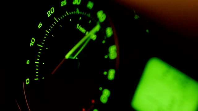 Movement of green car tachometer arrow video