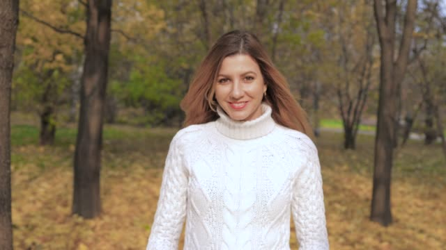 Movement Of Joyful Smiling Beauty Young Woman Enjoys Walks In The Autumn Park video