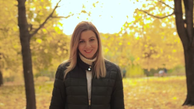 Movement Of Joyful Smiling Lovely Young Woman Enjoys Walks In The Autumn Park video