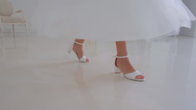movement of legs in the dance on the floor movement of legs in white shoes, in a dance on a mirror white floor in a white room dress shoe stock videos & royalty-free footage