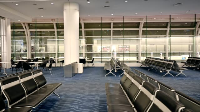 Movement on automatic walkway with chairs for passengers in airport