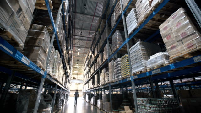 moving between palettes with ordered goods and materials at warehouse video