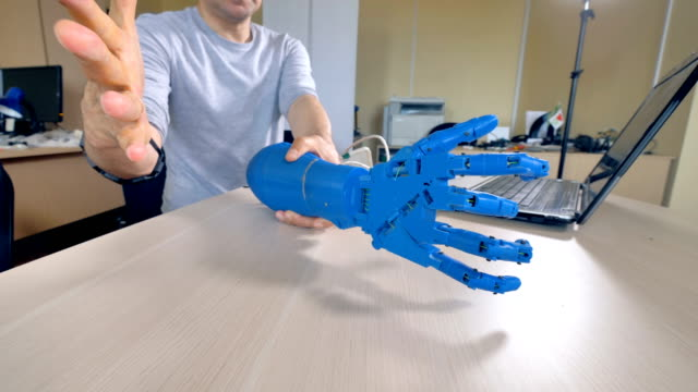 A moving bionic arm in close view from all sides. video