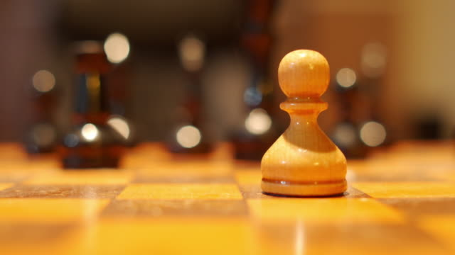 Moving chess figure in competition success . strategy leadership