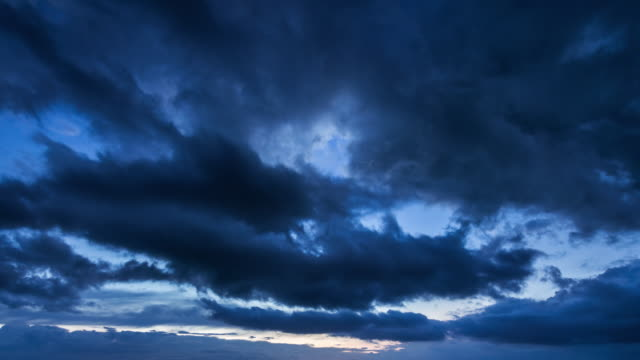 Moving Cloud at Sunset. Day to Night Time Lapse UHD Video