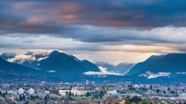 Moving clouds over Lynn valley, Vancouver Time lapse of moving clouds over Lynn Valley, British Columbia, Vancouver is in the foreground and snowy mountains in the background. vancouver canada stock videos & royalty-free footage