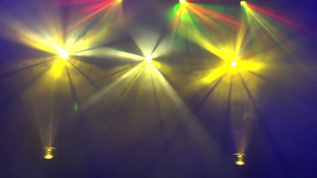Moving color spot lights on stage video