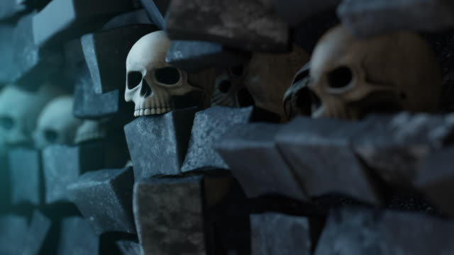 Moving Down Line of Skulls in Wall