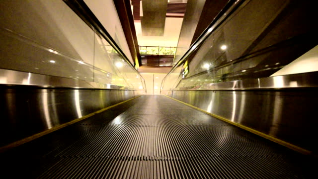 Moving empty travelator in a building video