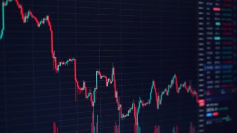 Moving financial chart with downtrend line candlestick graph and numbers in stock market on black color monitor Moving financial chart with downtrend line candlestick graph and numbers in stock market on black color monitor chart stock videos & royalty-free footage