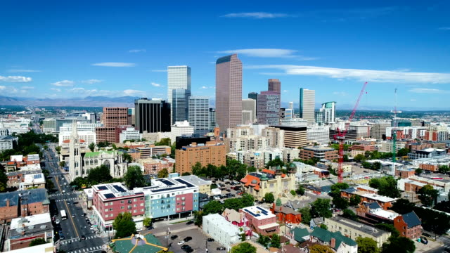 Moving forwards towards Denver Colorado Skyine Cityscape Modern Urban Sprawl city in the Rocky Mountains