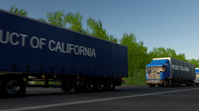 Moving freight semi trucks with PRODUCT OF CALIFORNIA caption on the trailer. Road cargo transportation. Seamless loop FullHD clip video
