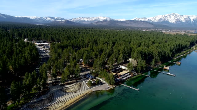 Moving lower and closer to shoreline along Lake Tahoe , California Natural Wonder of Mountains and Crystal Clear Lake