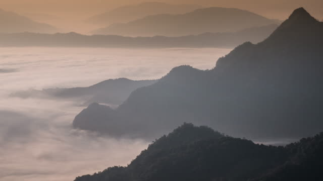 Moving mist on the mountain in the morning , 4k(UHD) video