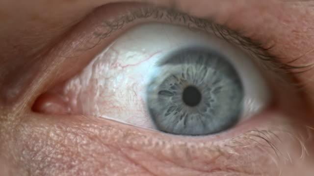 ECU Moving of a light blue colored iris video