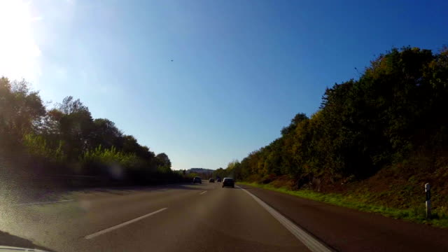 Moving on autobahn, German highway fast road, blue sky summer. Beautiful shot of Europe, culture and landscapes. Traveling sightseeing, tourist views landmarks of Germany. World travel, west European trip cityscape, outdoor shot video