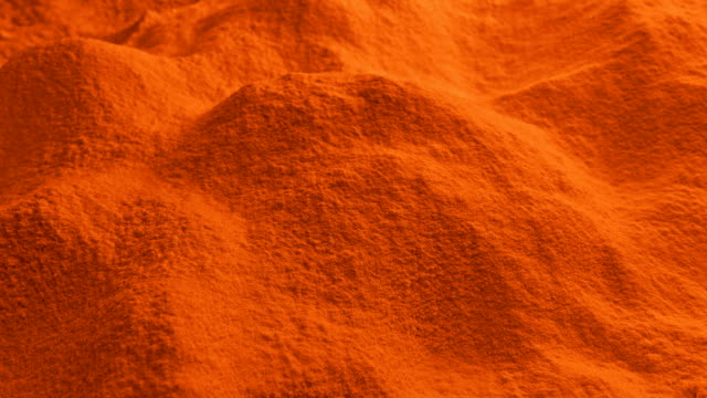 Moving Over Orange Powder Dolly shot moving slowly over pile of orange powder painting art product stock videos & royalty-free footage