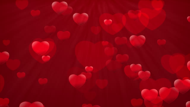 Moving Particles Loop - Heart particles on red background video