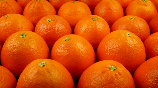Moving Past Delicious Oranges Slowly moving above many oranges peeled stock videos & royalty-free footage