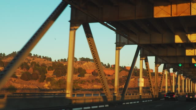 Moving scenery seen through the windows of a vehicle moving over the bridge in USA