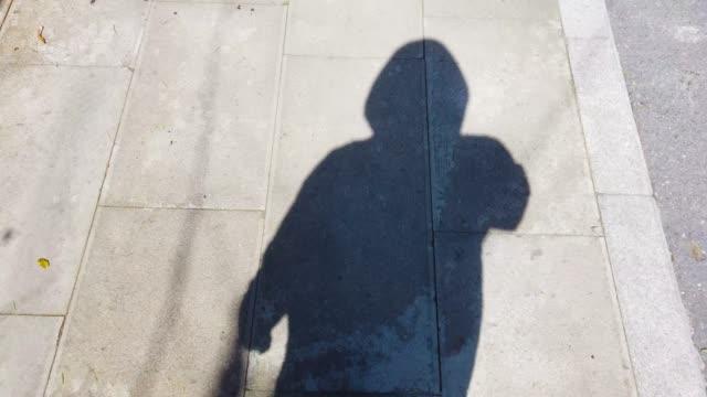 moving shadows of a men - penombra video stock e b–roll