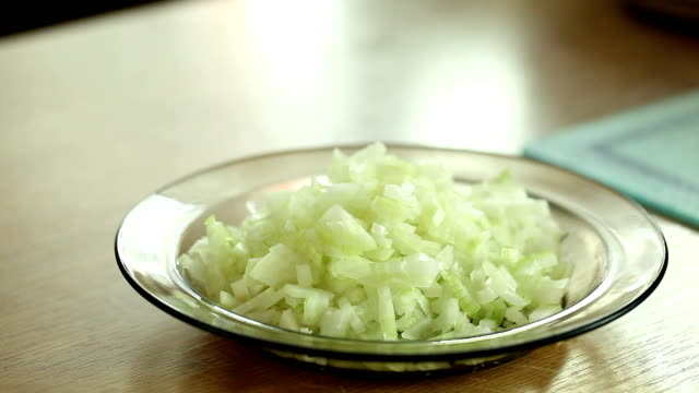 Moving small onion pieces to a bowl video