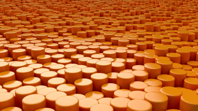 Moving surface made from orange cylinders. video