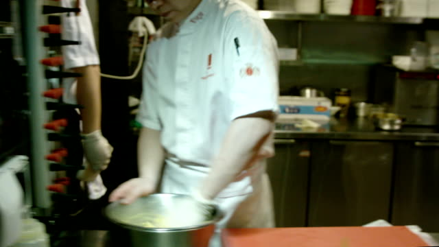 Moving through a professional commercial kitchen in a high-end restaurant. video