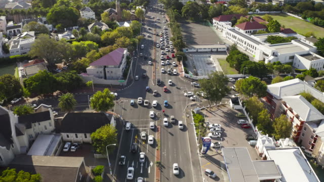 Moving through the city 4k video footage of cars travelling on a road in a city western cape province stock videos & royalty-free footage