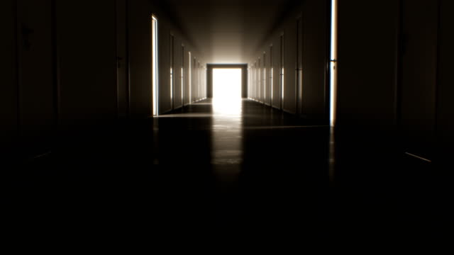 Moving Through the Dark Corridor with Many Opening and Closing Doors to the Bright White Exit. Business and Technology Concept.