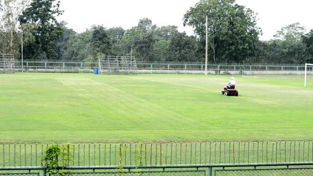 Mowing at football field video