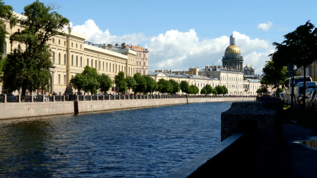 Moyka river and Isaac Cathedral in the summer day - St. Petersburg, Russia video