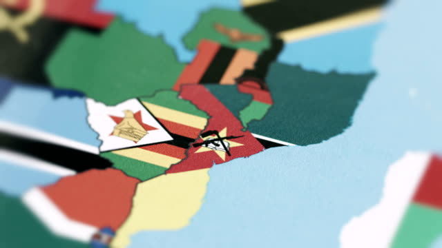 mozambique borders with national flag on world map - линия экватора стоковые видео и кадры b-roll