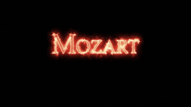 vídeos de stock e filmes b-roll de mozart written with fire. loop - compositor